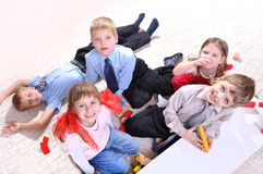 Children playing on the floor stock photography