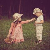 Children playing with flowers royalty free stock photos
