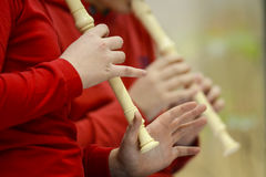 Children playing flute Stock Photography