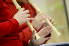Children playing flute Royalty Free Stock Photo