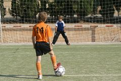 Children playing football. Heallthy fit children playing football Royalty Free Stock Image