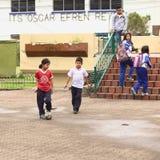 Children Playing Football in Banos, Ecuador Royalty Free Stock Image