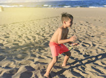 Children playing football on the beach.  Royalty Free Stock Photography