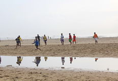 Children playing football in the beach, India. We can see children playing football in the beach Stock Photography