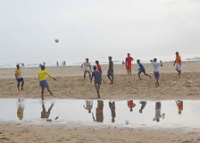 Children playing football in the beach, India. We can see children playing football in the beach Stock Images