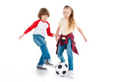 Children playing football. Boy and girl playing football isolated on white, children sport concept royalty free stock photos