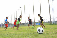 Children playing football on the field Royalty Free Stock Photos