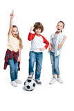 Children playing football. Group of cute kids playing football isolated on white, children sport concept stock photos