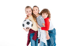 Children playing football. Group of friends playing with soccer ball isolated on white, children sport concept royalty free stock photo