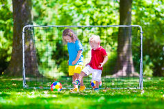 Children playing football outdoors Royalty Free Stock Image