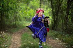Children playing in the forest wearing costumes. Poland royalty free stock image