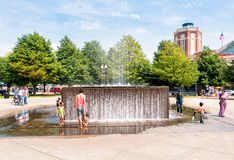 Children playing with fountain Stock Photography