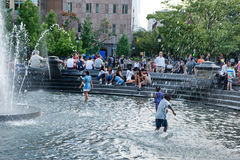 Children playing in a fountain in New York stock photography