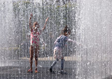 Girls dancing in the fountain Stock Photo