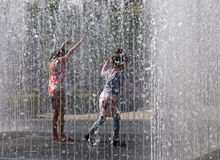 Children playing in the fountain Royalty Free Stock Photos