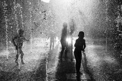 Children playing in a fountain Royalty Free Stock Photos