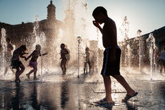 Children playing in a fountain Royalty Free Stock Photography