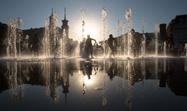 Children playing in a fountain Stock Photo