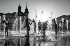 Children playing in a fountain Royalty Free Stock Photo