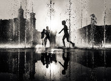 Children playing in a fountain Stock Photography