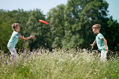 Children playing frisbee Stock Image