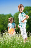 Children playing frisbee Royalty Free Stock Photo