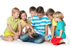 Children playing with a gadget Stock Photos