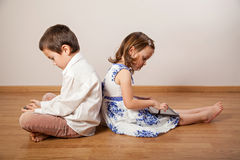 Children playing with gadgets Stock Photos