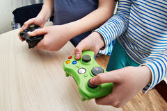 Children playing on games console Stock Photography