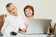 Children playing games on laptop computer Royalty Free Stock Images