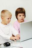 Children playing games on laptop computer Royalty Free Stock Photo
