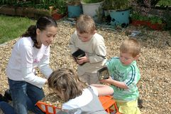 Children playing in garden. Stock Images