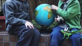 Children playing with Globus stock video