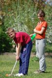 Children playing golf Stock Photography