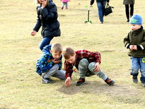 Children playing on the grass Royalty Free Stock Photos