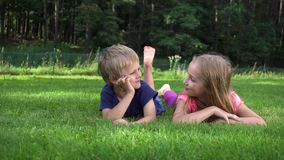 Children playing on the grass stock video footage