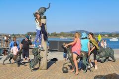 Children playing on `Hairy Maclary` animal sculptures, Tauranga, New Zealand. A group of children playing on and around the Hairy Maclary sculptures on Tauranga` stock photography