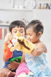 Children playing hand puppet Royalty Free Stock Photo