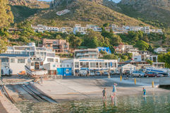 Children playing at the harbor in Gordons Bay Royalty Free Stock Photos