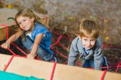 Children playing when having fun doing activities outdoors. Stock Photo