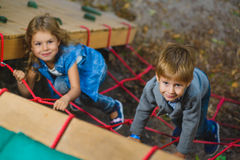 Children playing when having fun doing activities outdoors. Royalty Free Stock Photos