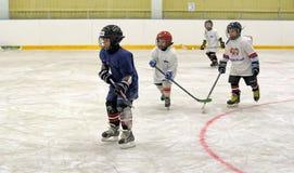 Children playing hockey Stock Photos
