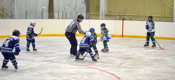 Children playing hockey Stock Images