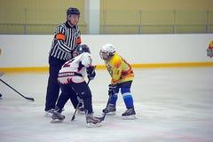 Children playing hockey Stock Photography