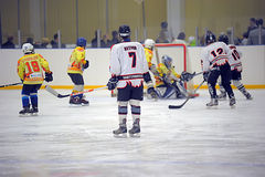 Children playing hockey Stock Photography
