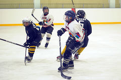 Children playing hockey Stock Photos