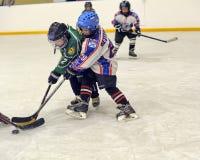 Children playing hockey Royalty Free Stock Photo
