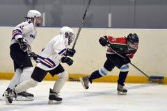 Children playing hockey Stock Photo