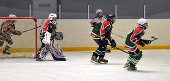 Children playing hockey Royalty Free Stock Photography