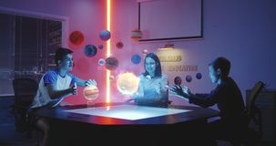 Children playing with holographic solar system
